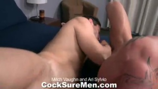 Muscle men Mitch and Ari swap blowjobs and fuck