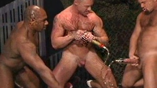 Leathermen in cock pumping sex