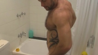 Hunky and hairy Aaron showers