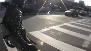 Man Bound in Leather Body Suit Rolled Thru Streets