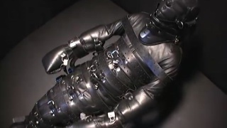 Leather Man Bound in Full Body Suit