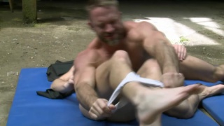 Daddy wrestles a cute bottom jock