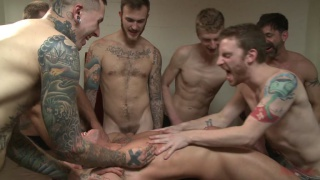 Crowd mercilessly gang fucks a tied-up hung stud
