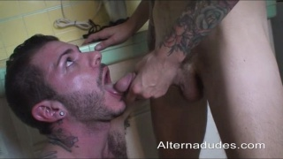 Blowjob in the kitchen with two rough tattooed guys