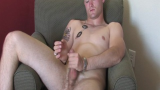 Strapping military lad jerking