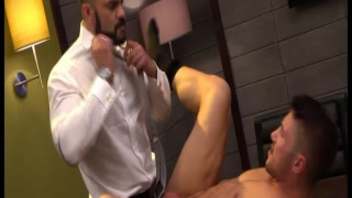 Marco Rubi fucked by suited and muscular Rogan Richards