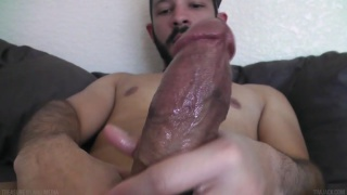 Bearded tanned hung Dylan jerks off