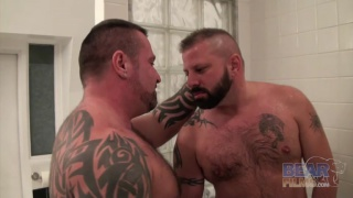Marc Angelo and Cooper Hill in the bathroom