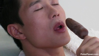 Asian muscle model Peter Lee playing with frozen banana
