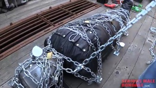 extreme bondage in chains and bodysack