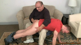 Chubby dad spanks a bare bottom