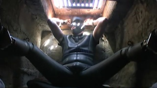 leather sub in underground cage