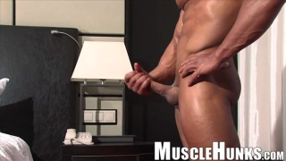 cosmo is a powerful bodybuilder with a big cock