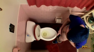 Unloading his nuts In The Toilet Bowl