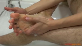 dan gives his stinky feet a bath