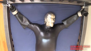 rubber suit sub restrained to bed