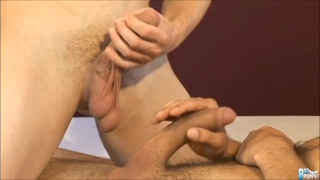 2 euro boys work their thick cocks in side-by-side action