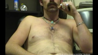biker with big mustache jerks uncut cock