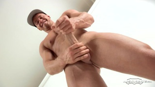 muscle hunk in ball cap masturbating