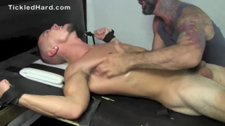 wrestler strapped down and tickled