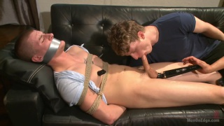 bound stud at mercy of two perverted captors