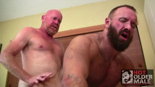 bald man and bearded hunk fuck each other