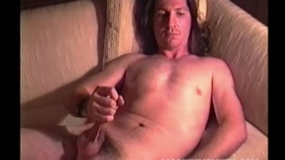 long-haired billy cums on his belly