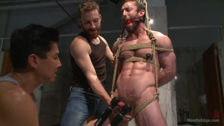 cop gets tied up and edged by 2 toilet tramps