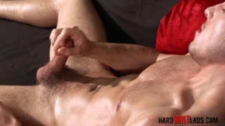 brit with fit body stroking his foreskin cock