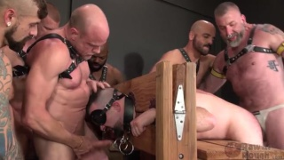 7 leather men continue fucking this cum-hungry bottom