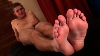 jakub shows off his bare feet