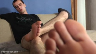 ben plays with his feet and 8-inch uncut cock