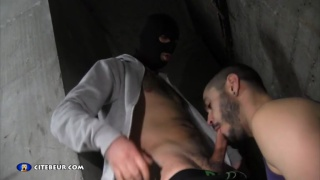 hooded man uses a cocksucker's ass