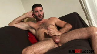 handsome and hairy brit strokes his dick