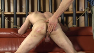 tall lean stud roped to a couch and spanked