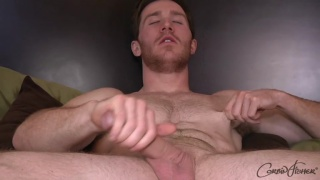 hunky ginger strokes his cock