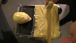 blond sub wrapped in plastic and yellow duct tape