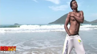dark-skinned latino naked on the beach