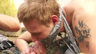 2 nasty soldiers share a roped guy