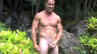 surfer jerks his big Puerto Rican dick