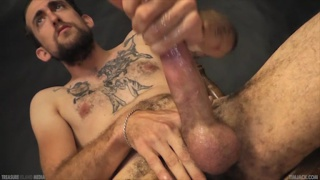 bearded tattooed dude firing off a load