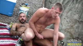 Alessio Romero flip flops bare with Billy Warren outdoors