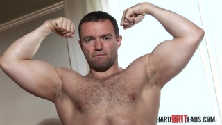 big beefy bloke strokes his dick