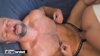 bottom plays with nipples while getting fucked