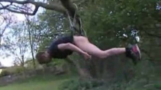 straight lad dangling from the tree