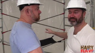 Guy English and Joe Hardness fuck on Scaffolding