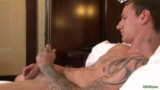 inked stud jacks his meaty cock
