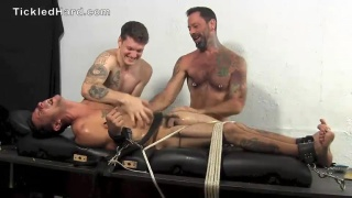 sexy victor strapped down and tickled by two guys