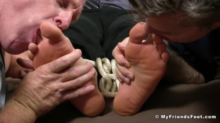 two men tickle and worship stock brocker's feet