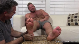 Aaron Bruiser gets his bare feet worshipped